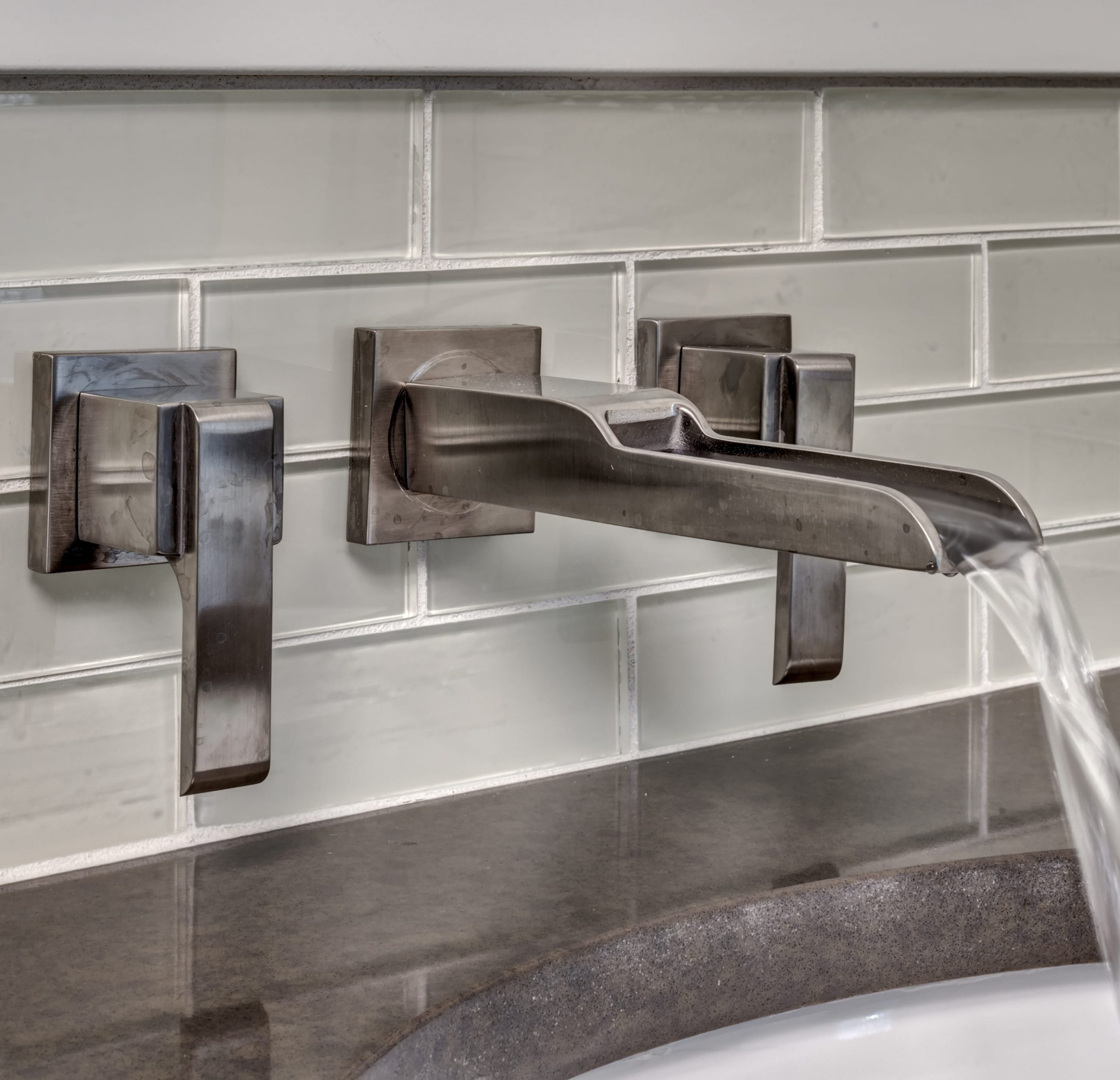 Water Empties from Quality Faucet into Bathroom Sink